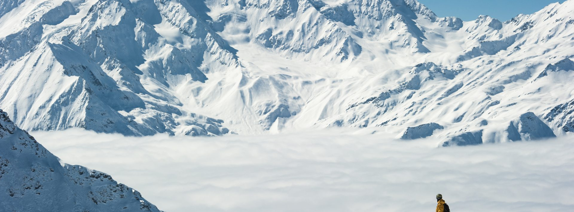 André Sommer stands above the clouds on a powder day in Verbier, Switzerland